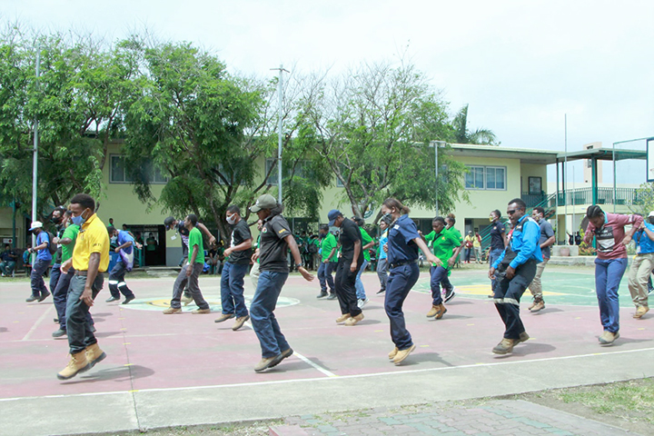 Staff and Students of Don Bosco Technical College perform and dance with marked spots to maintain social distancing, Papua New Guinea