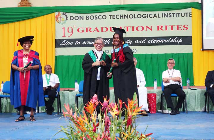 Don Bosco Technological Institute student receives a bachelors degree during the 19th Rite,  Port Moresby, Papua New Guinea