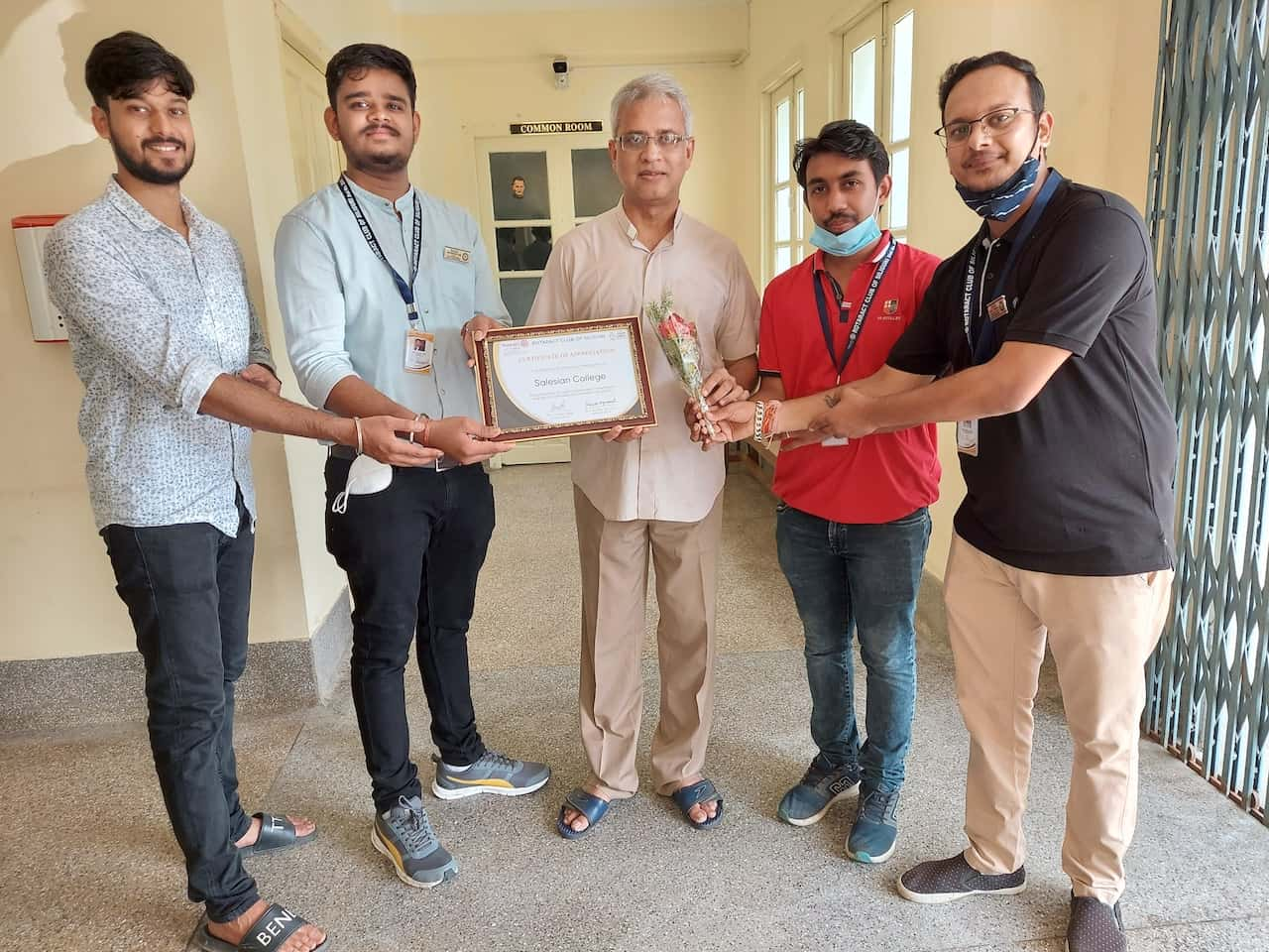 Salesian College Principal Father George Thadathil receives the honor certificate from Rotaract Club of Siliguri in appreciation of the college's outstanding commitment and valued contribution towards the nation.